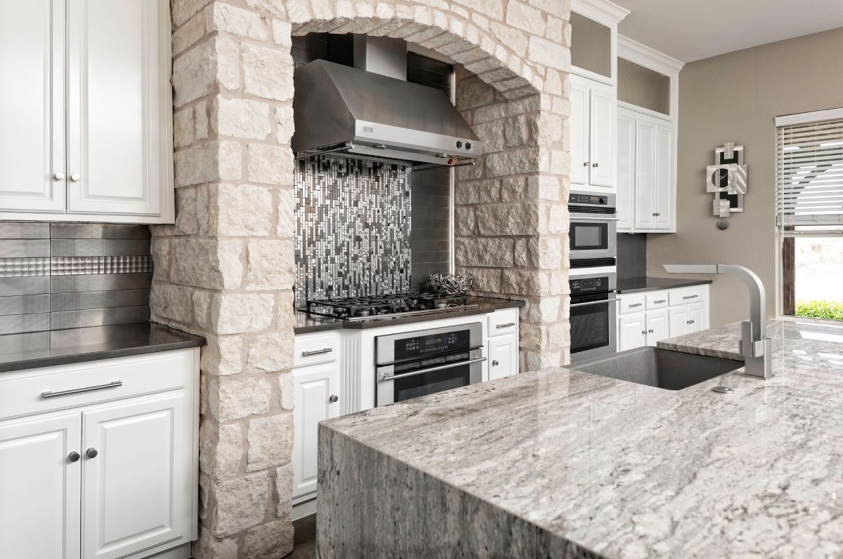 Remodeled kitchen stove area with vent