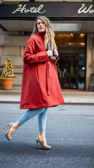 Woman in Red swing coat
