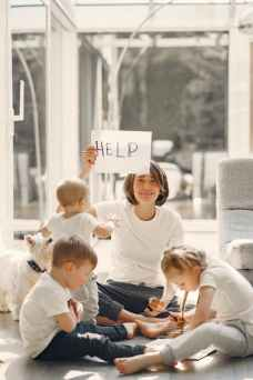 tired mother asking for help while sitting with children, virtual learning