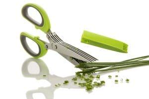The Freshcut herb scissors cutting green onions.
