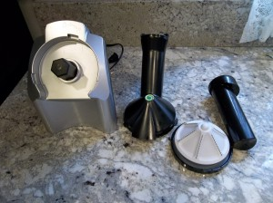 The yonanas machine taken apart showing all individual pieces.