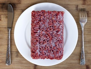 Table setting with frozen ground lean beef.