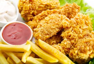 Fried chicken, fries, and ketchup.