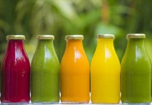 Organic raw vegetable juices in glass bottles.