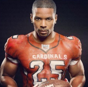 Kerry Rhodes claims he is not gay after being photographed carrying a man that he said is his assistant.