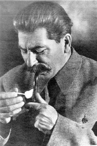 photo of stalin smoking, along with shakespearean quote, The evil that men do lives after them; The good is oft interred with their bones