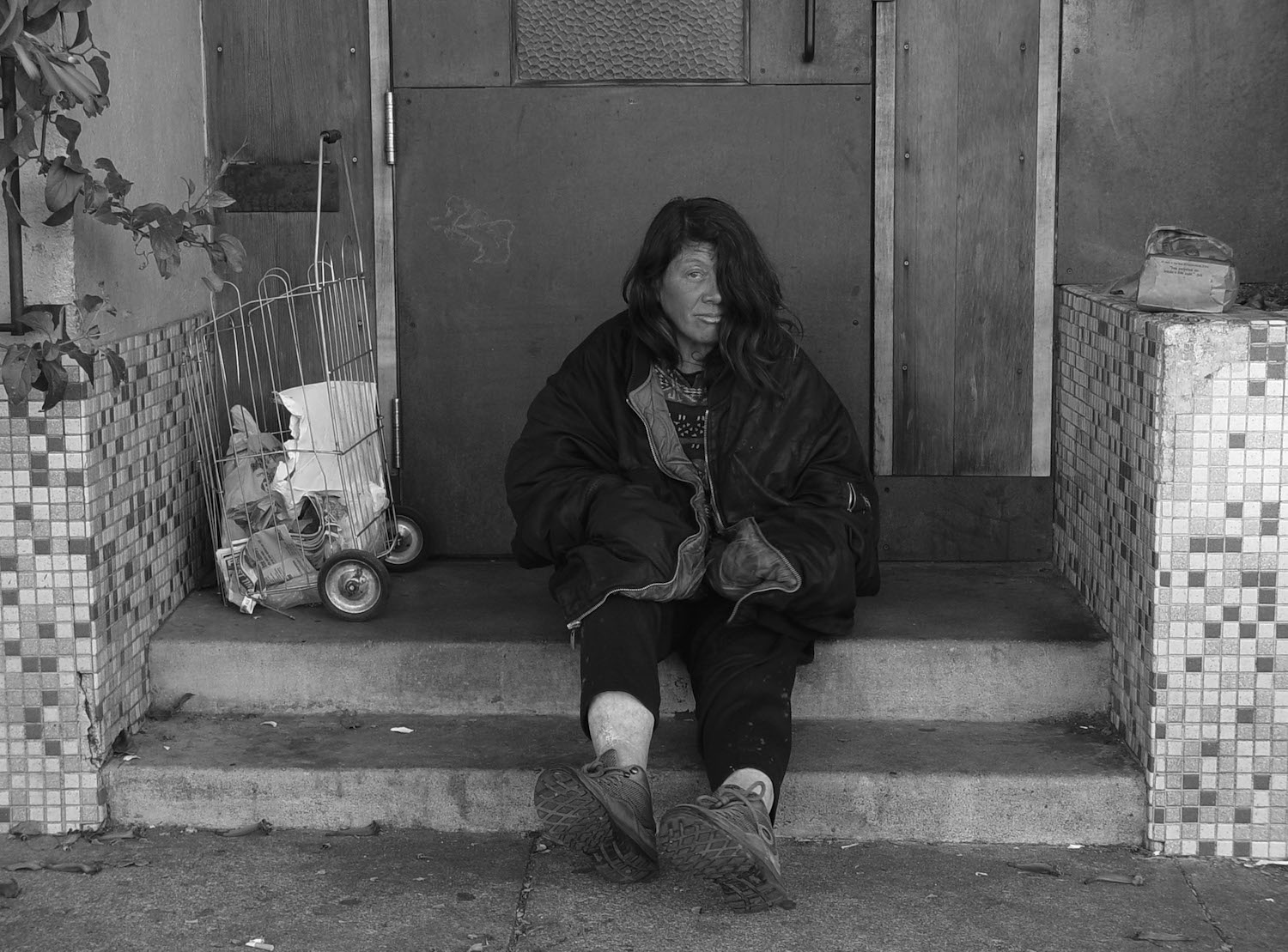 Homeless woman in San Francisco, CA. Photo by Franco Folini