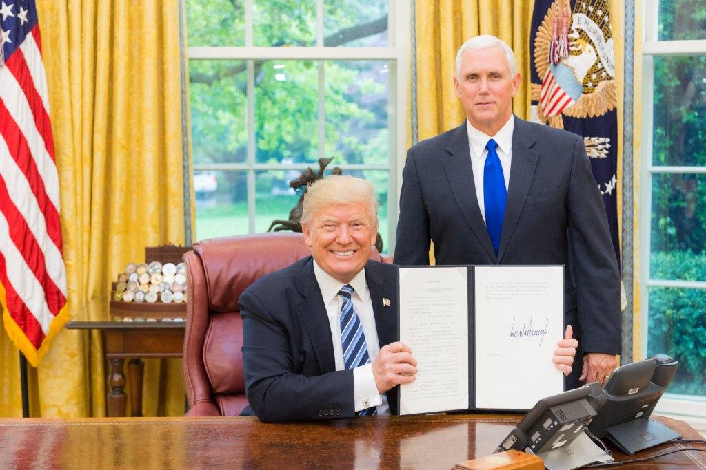 Trump signs executive order pre-pardoning himself