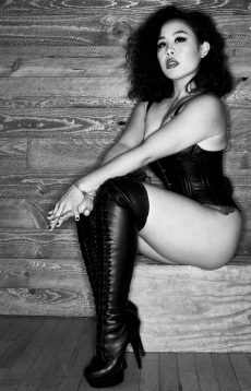 Black and white photo of Asian Leather Mistress An Li. By Mark Dektor.