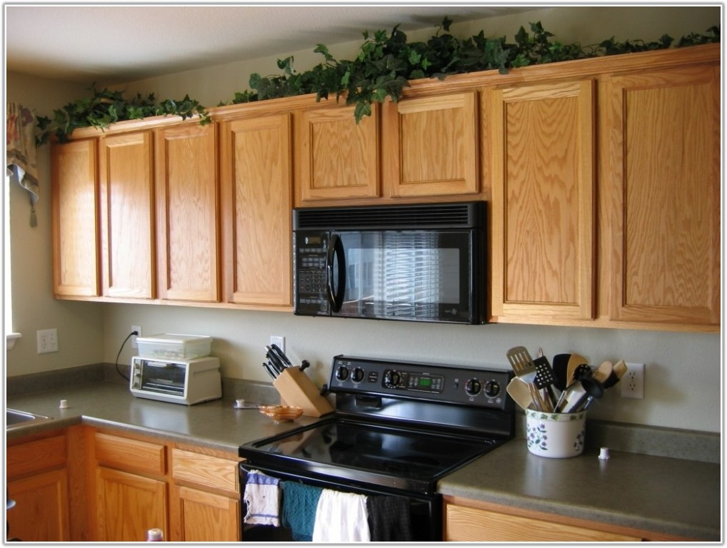 Modern Decor For Above Kitchen Cabinets