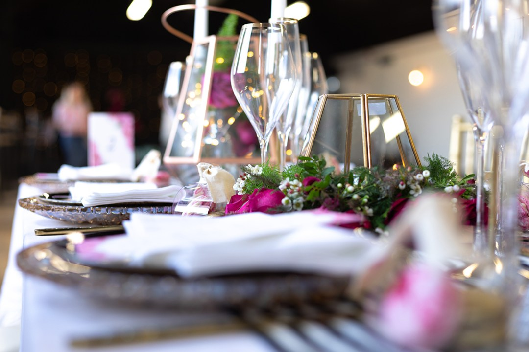 Dry Hire Wedding - Black & Gold Table setting with hot pink details