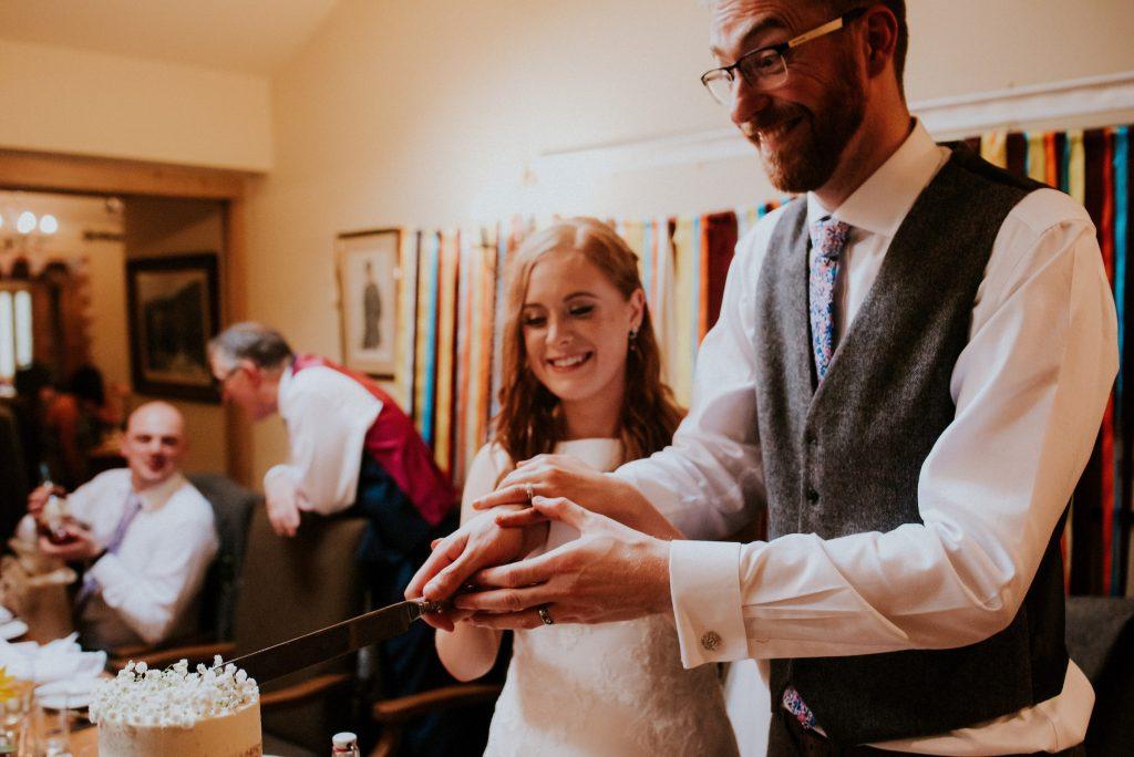 Rosie & Scott cutting the cake, Burnsall Wedding