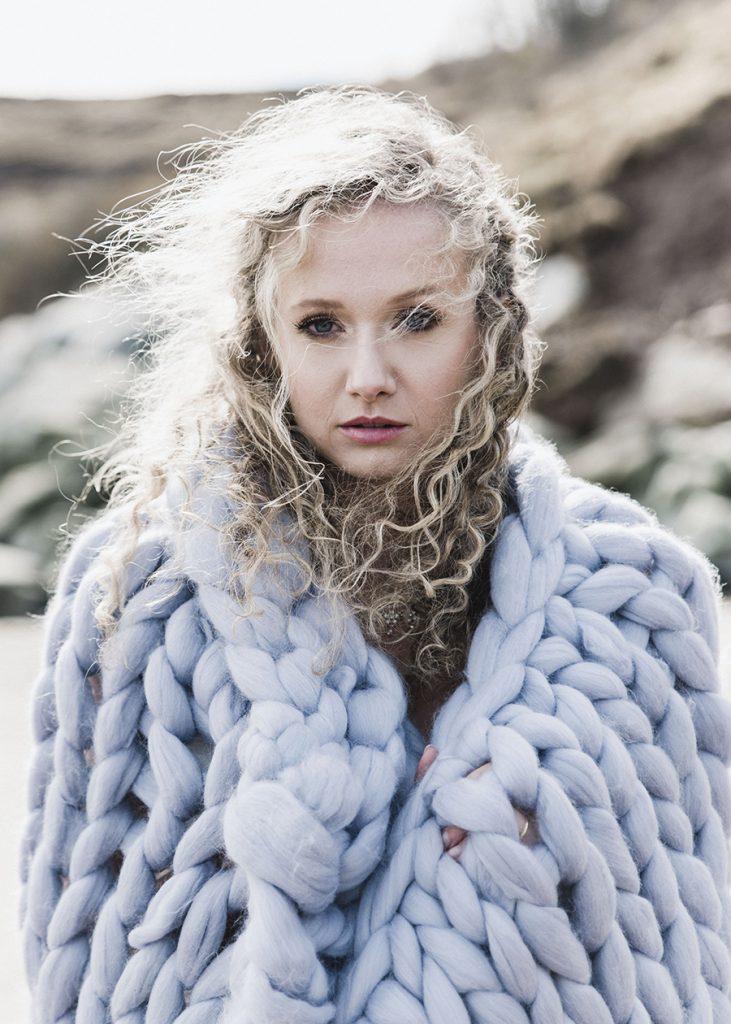 Winter wedding, bride with merino wool blanket