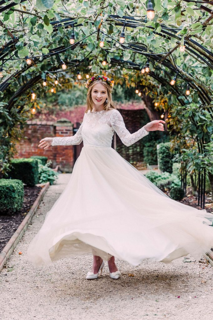 Bride twirling under the arch at the Walled Garden Autumn Wedding