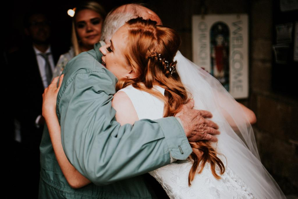 Bride Hugging Guest at St Wilfrid's Church Burnsall
