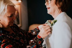 Louise Helping the bride's mum with her buttonhole