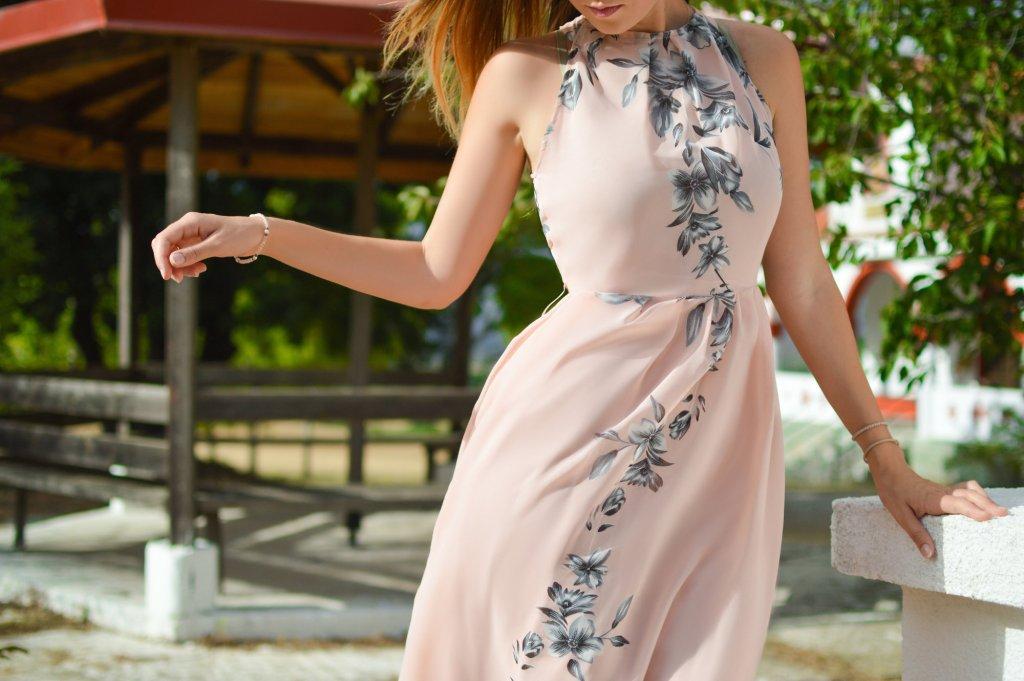 Woman in pretty pink dress