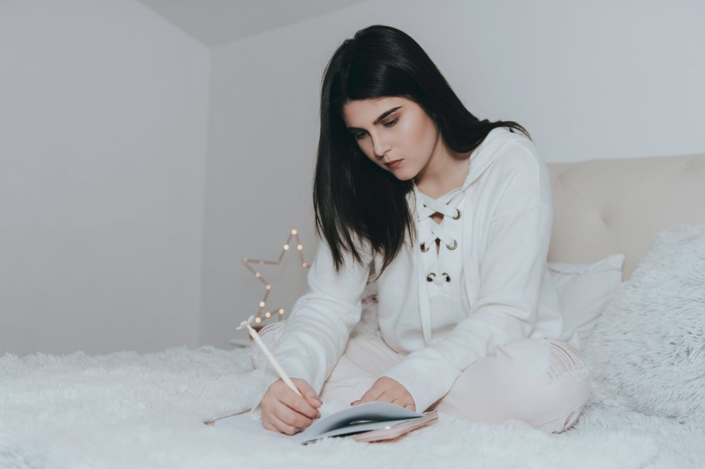 Girl on her bed planning