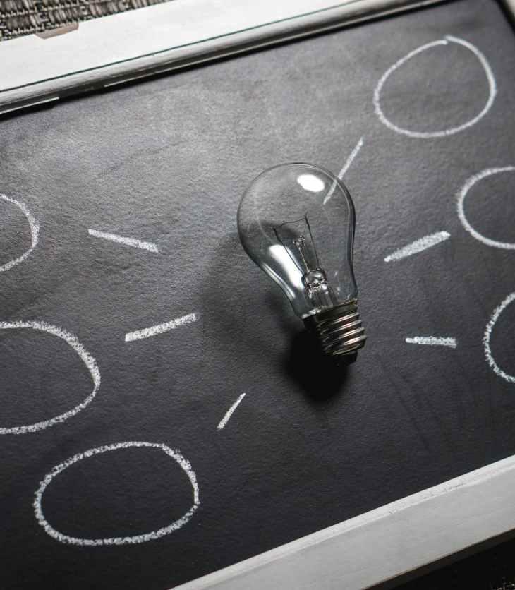 clear light bulb on black surface