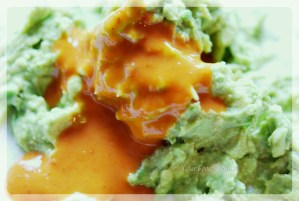 Mashed Avacado, green peas, lime juice and Nandoos Sauce for Avocado Eggs at your food fantasy | YourFoodFantasy.com