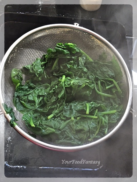 Draining water from boiled spinach | YourFoodFantasy.com