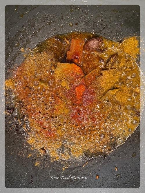 Adding red chilli and coriander powder