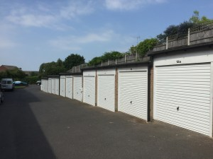 Garage block fitted with Hormann white horizontal up and over garage doors