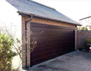 Ryterna Mid Rib Sectional Garage Door in Rosewood