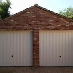 Two White Vertical ribbed doors