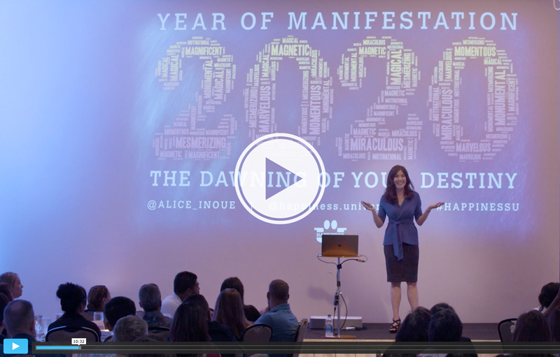 Alice Inoue standing in front of 2020 Year of Manifestation screen