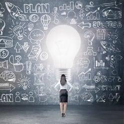business-woman-standing-light-bulb