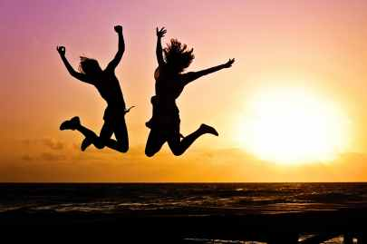 silhouette photography of jump shot of two persons