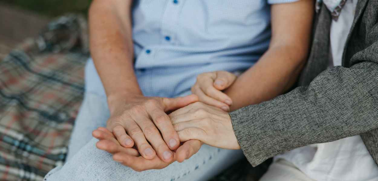 two people holding hands together
