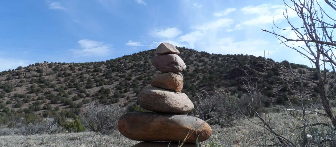 Balancing river rocks in the desert