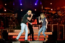 """NASHVILLE, TN - MAY 06: Singer-songwriters Luke Bryan (L) and Carrie Underwood (R) perform on stage and Kicks off the """"Huntin', Fishin' And Lovin' Every Day"""" Tour at Bridgestone Arena on May 6, 2017 in Nashville, Tennessee. (Photo by John Shearer/Getty Images for Schmidt PR) *** Local Caption *** Luke Bryan;Carrie Underwood"""