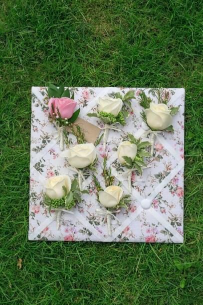 """Rose buttonholes by """"Your London Florist"""""""