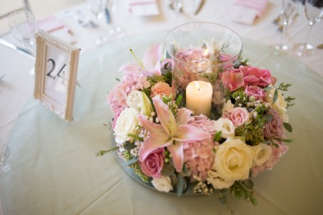 """Candle wedding centrepiece by """"Your London Florist"""""""