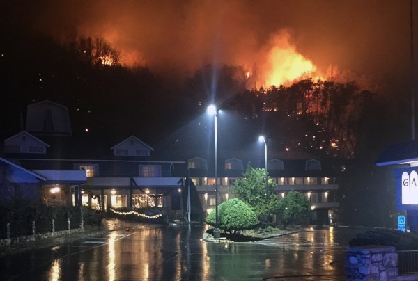 A wildfire burns on a hillside after a mandatory evacuation was ordered in Gatlinburg