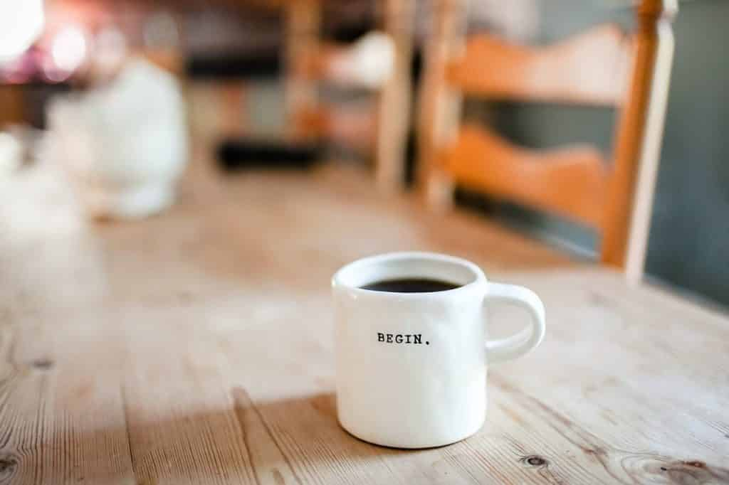 Picture of a coffee mug with begin written on it
