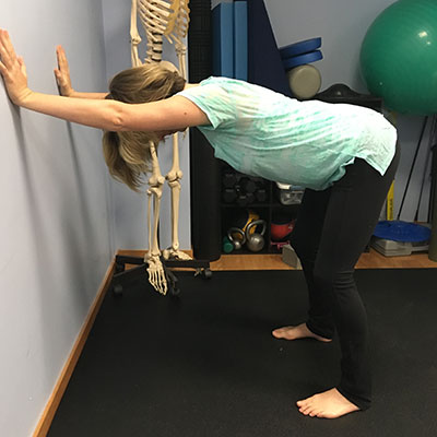 Use a wall while doing Downward Facing Dog for support during prenatal yoga
