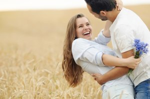 stunning sensual young couple in love posing in summer field happy lifestyle concept