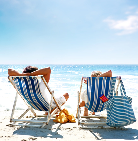 http://www.dreamstime.com/royalty-free-stock-images-couple-deck-chair-relaxing-beach-image8701309