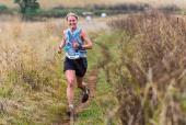 Kim Westbrook smiles on her way to the finish of the Karkloof Classic trail run that took place today. Photo: Anthony Grote