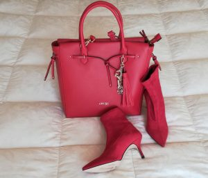 red ankle boots and red bag