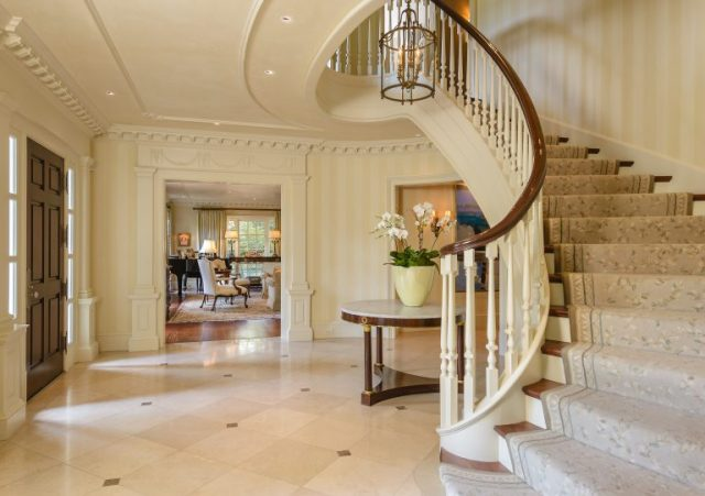 "Curved staircase in marble entry foyer - North Dallas mansion featured in the TV show ""Dallas"" via RIS Media - Bill Salvatore, Arizona Elite Properties 602-999-0952 - Arizona Real Estate"