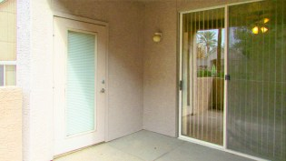 Private patio enclosed with waist-high wall, sliders from bedroom, door from living area - 5303 N 7th St, Phoenix AZ - Small private patio area - Bill Salvatore, Arizona Elite Properties 602-999-0952 - Arizona Real Estate