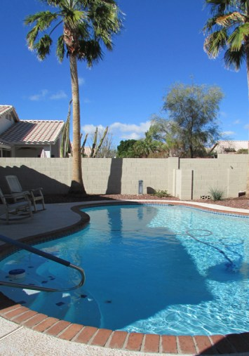 Swimming pool with steps and railing, surrounded by cool-deck patio - 4446 E Desert Wind Dr, Phoenix / Ahwatukee AZ - For Rent - pool service and landscaping service included - Bill Salvatore, Arizona Elite Properties -602-999-0952 - Elite Property Management