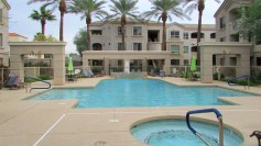 Three-story condo buildings surrounding pool complex - 5303 N 7th St, Phoenix AZ - Community Pool and Spa - Bill Salvatore, Arizona Elite Properties 602-999-0952 - Arizona Real Estate
