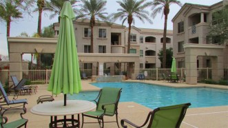 Clean and well cared for, patio with sitting area and tables next to pool - 5303 N 7th St, Phoenix AZ - Popular Carlyle Condominiums, minutes to shopping, restaurant, city services - Bill Salvatore, Arizona Elite Properties 602-999-0952 - Arizona Real Estate