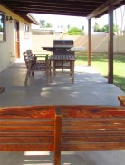 concrete back patio from behind wood chair-swing - 783 W Park Ave, Chandler Arizona - Covered patio and big back yard - Bill Salvatore, Arizona Elite Properties 602-999-0952 - Arizona Real Estate